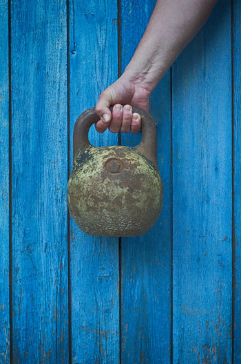 Close-Up Of Human Hand Holding Kettlebell