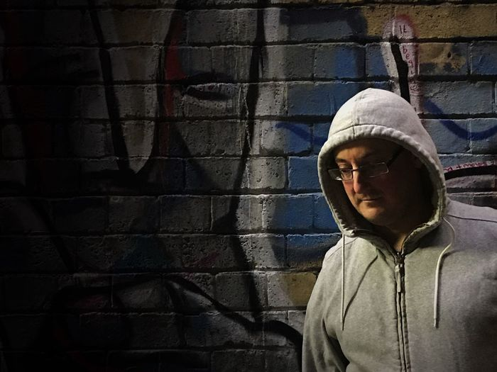 Vignette Outdoor Portrait Real People Standing Lifestyles Young Adult One Person Hoodie Night Night Photography Graffiti Nightphotography Portrait Night Out Man Outdoor Photography Nightlife Urban Lifestyle Filtered Image Portrait Photography Urban Urban Photography City Life City At Night Outside