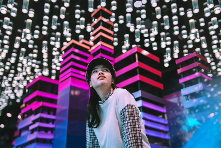 City light. Night Light One Person Waist Up Illuminated Technology Looking Up Glowing Smiling Indoors  Real People Adult Looking Away Portrait Light Light And Shadow Lights Lighthouse Music Bokeh Bokeh Photography Sound Volume Celebration Christmas