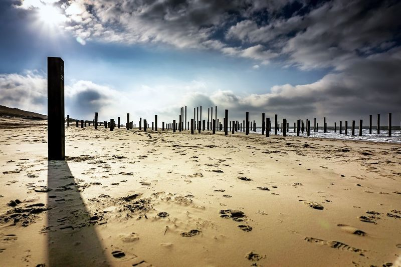 Moody Sky Landscape Nature Clouds Sky Beach Land Cloud - Sky Sand Nature Sea Tranquility Water Beauty In Nature Day Horizon Over Water Wooden Post No People Scenics - Nature Outdoors Tranquil Scene
