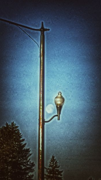 From this morning's walk. I noticed that the moon lined up perfectly to be framed by this city lamp. KimberlyJTilley Lighting Equipment Sky Nature No People