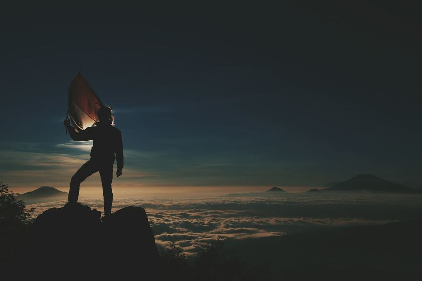 One Man Only Only Men One Person Adventure Adults Only Adult Full Length Mid Adult People Silhouette Headwear Standing Night Outdoors Men Landscape Sky Arts Culture And Entertainment Silhouette Sunset EyeEmNewHere Human Body Part INDONESIA Travel Photography