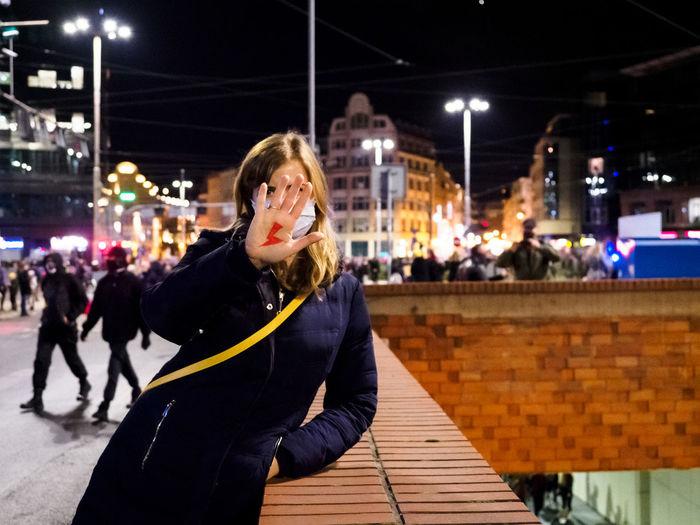 Woman has drawn a sign lightning oh hand. women protest against abortion in poland.