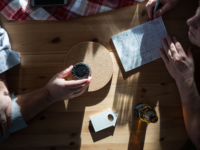 High Angle View Of People Playing Dice Game On Table