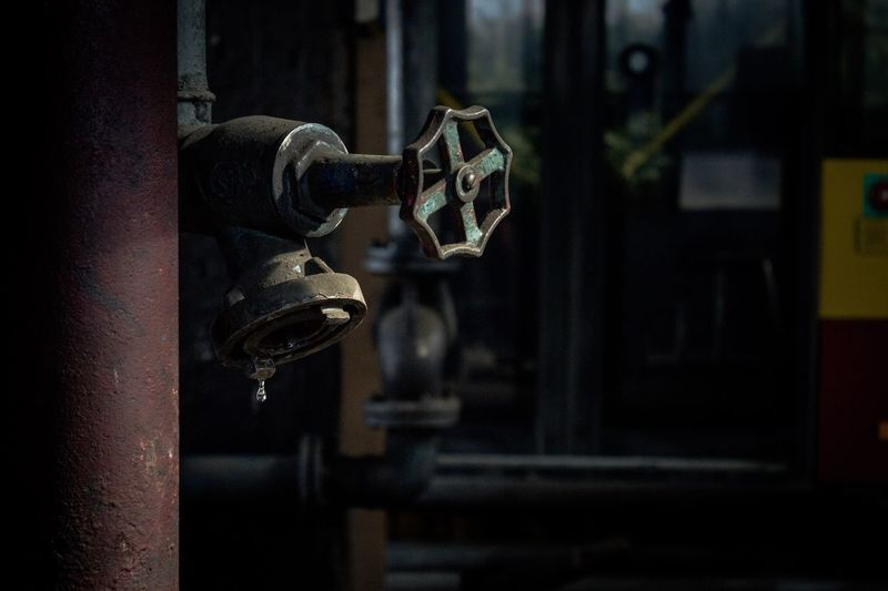 Focus On Foreground Metal No People Machinery Factory Industry Close-up Architecture Valve Sun Pipe - Tube Indoors