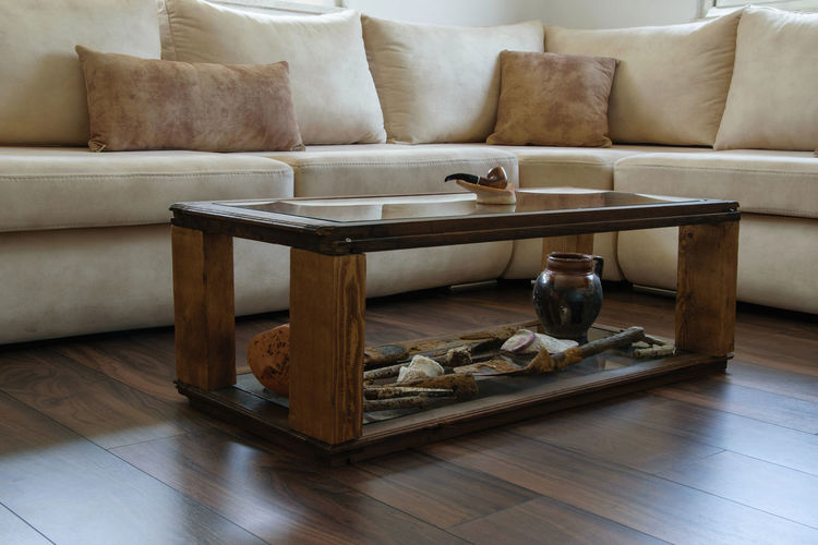 Coffee table by sofa at home