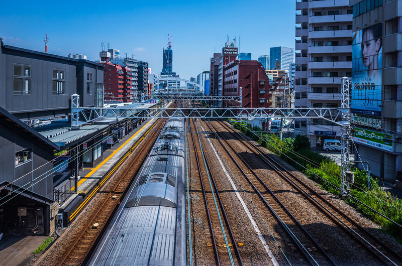 Daytime Japan Japan Lovers Japan Photography Railroad Track Sky And City Train Tracks Travel Trip Architecture Building Building Exterior Built Structure City Cityscape Daily Life Day High Angle View Japan Scenery Japan Travel Journey Mode Of Transportation Nature No People Office Building Exterior Outdoors Platform Public Transportation Rail Transportation Railroad Station Railroad Station Platform Railroad Track Shunting Yard Sky Skyscraper Track Train Train - Vehicle Train Station Transportation Travel Travel Destinations