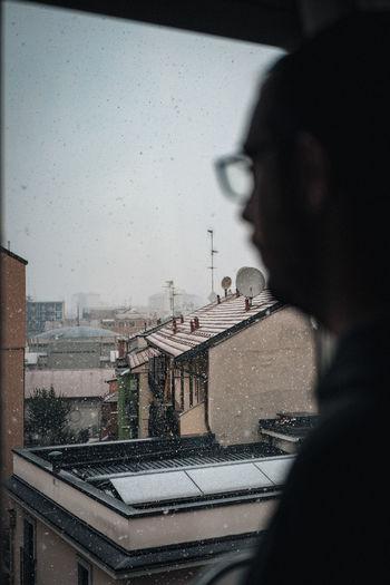 Portrait of wet glass window in city