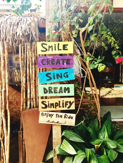 Good advice from Jericoacora Good Words Life Advice Enjoy The Ride Simplify Dream Sing Create Smile Text Communication Western Script Information Sign Day Information Sign No People Wood - Material Outdoors Guidance Board A New Beginning