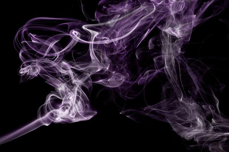 Purple Smoke Against Black Background