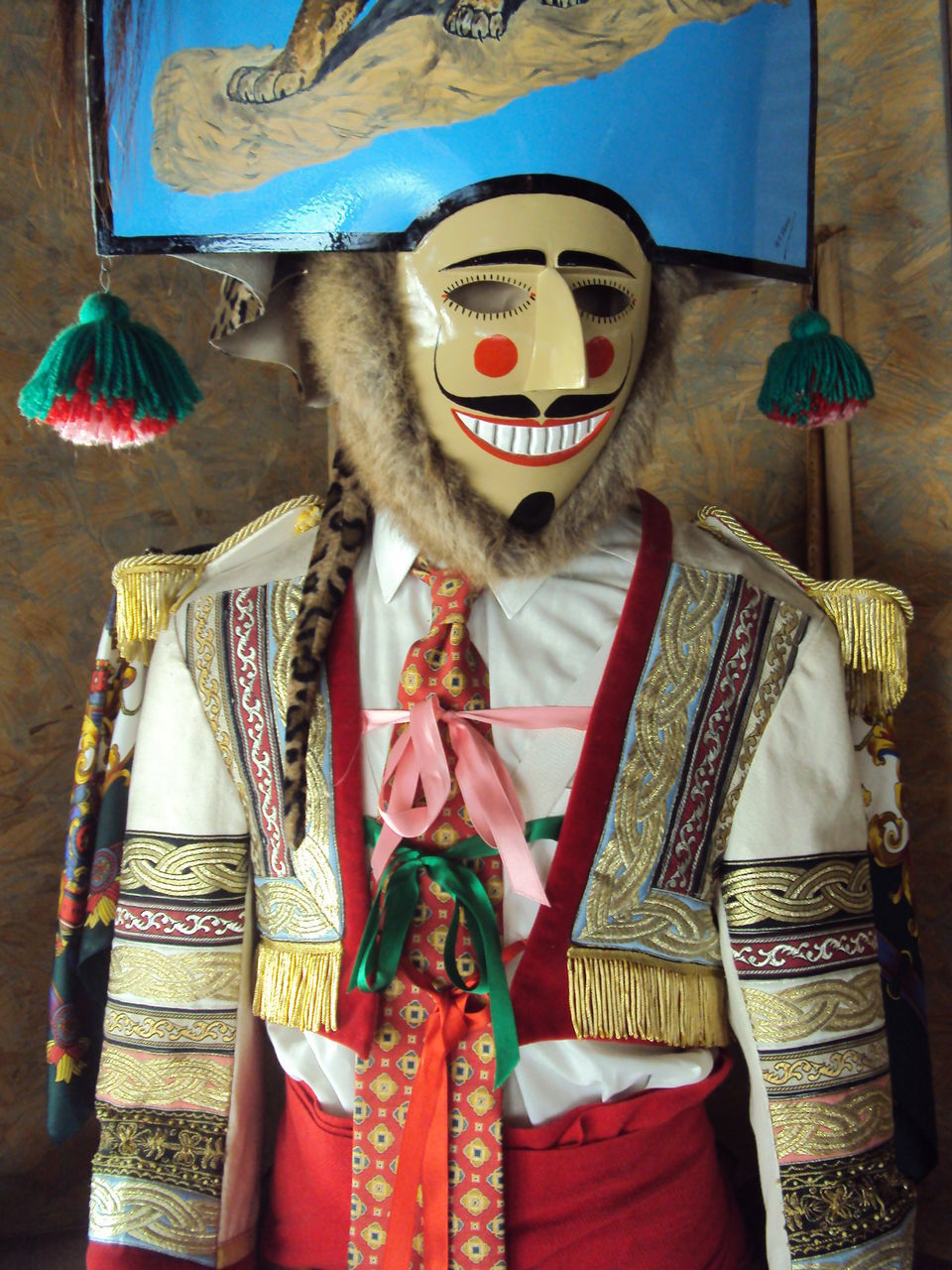 FULL LENGTH OF MAN STANDING BY MASK IN TRADITIONAL CLOTHING