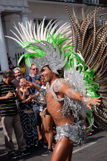 Male Dancer, London School of Samba Carnival Composition Dancing Feathers GB London Man Arts Culture And Entertainment Carnival - Celebration Event Carnival Costume Dancing Enjoyment Full Frame Fun Green And Silver Colour Happiness Incidental People London School Of Samba Male Dancer Nottinghill Carnival 2017 Outdoor Photography Performance Side View Smiling Face Uk