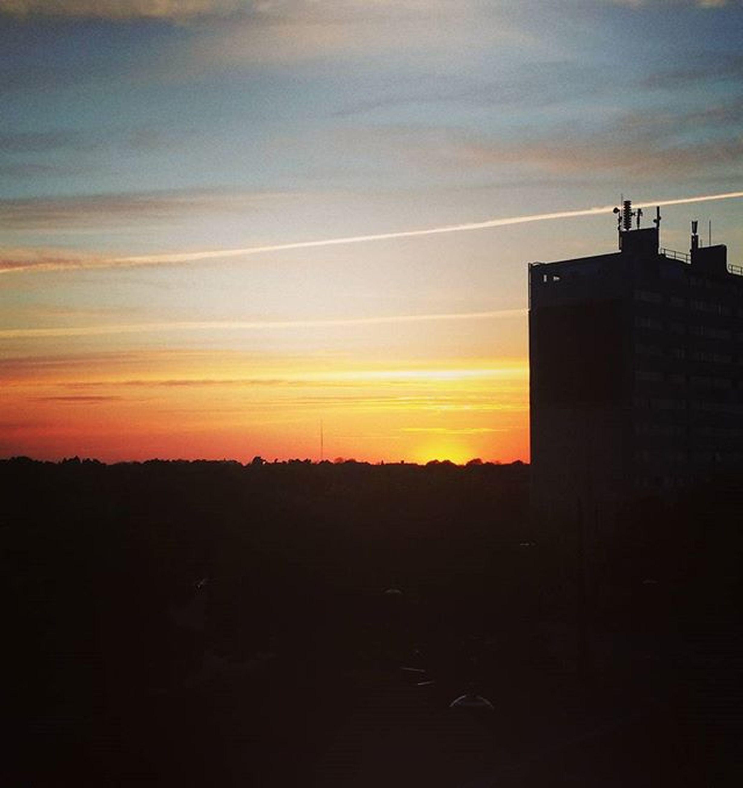 sunset, silhouette, orange color, sky, scenics, beauty in nature, built structure, tranquil scene, dark, building exterior, tranquility, architecture, nature, idyllic, landscape, cloud - sky, copy space, outline, cloud, outdoors