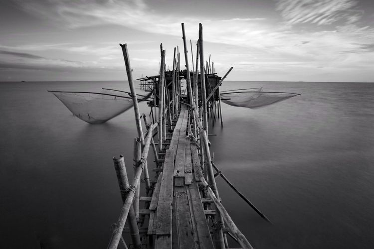 Langgai (fishing jetty), Batu Pahat, Johor, Malaysia. Fishing Platform Platform Onshore Offshore Monochrome Seascape Landscape Agriculture Fisherman Nature Malaysia Jetty Fishing Langgai Black And White Bnw Sky Water Nature Outdoors Cloud - Sky No People Nautical Vessel Wood - Material Sea Horizon Over Water Day Beauty In Nature Scenics