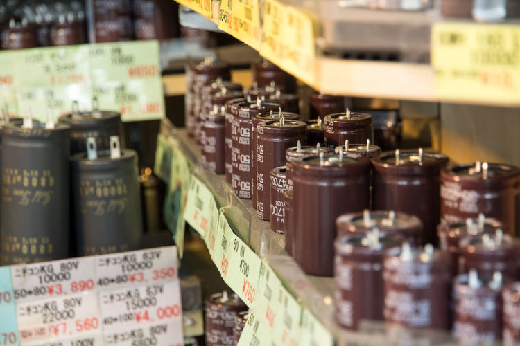 Close-up of containers in store
