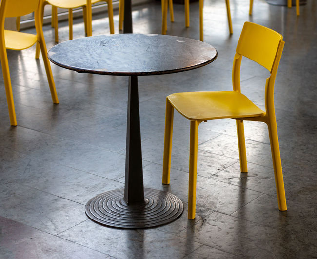Yellow chairs at cafe in train station