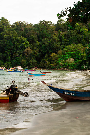 Beach Beauty In Nature Boat Day Longtail Boat Mode Of Transport Moored Nature Nautical Vessel Outdoors Outrigger Real People River Scenics Sky Transportation Tree Water