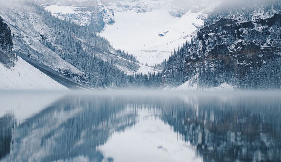 Scenic View Of Lake Against Snowcapped Mountains During Winter
