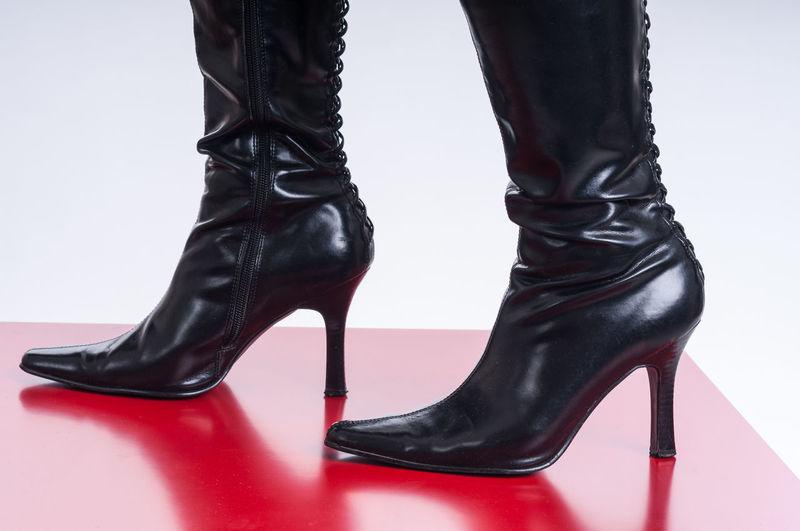 Black festish boots on red background Boots Foot Glamour Shots Leather Woman Close-up Clothing Dress Shoe Elégance Erotic_photo Erotık Fashion Fashion Model Fetish Glamour High Heels Human Foot Human Leg Luxury Pair Red Shadow Shoe Style