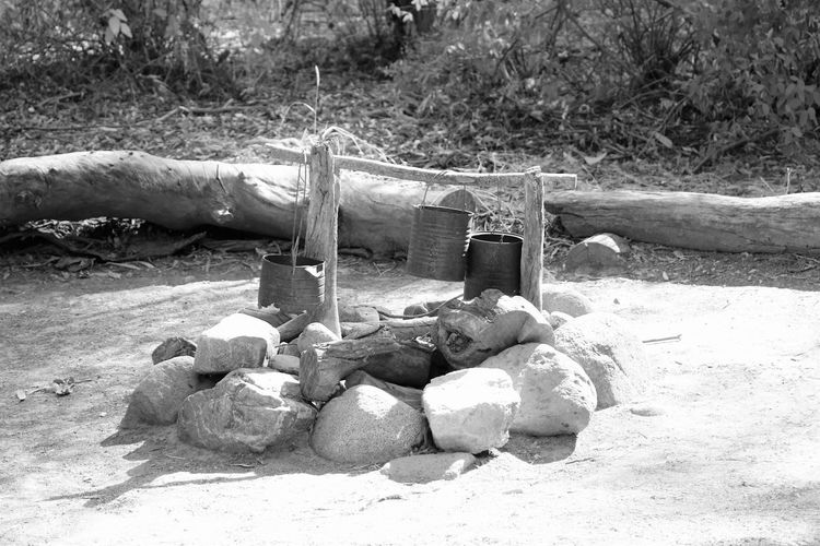 Papago Park Area Campfire The Still Life Photographer - 2018 EyeEm Awards B & W Photography Fire Camp Focus On Foreground Nature No People Outdoors Rustic Style Tree Wood Wood - Material