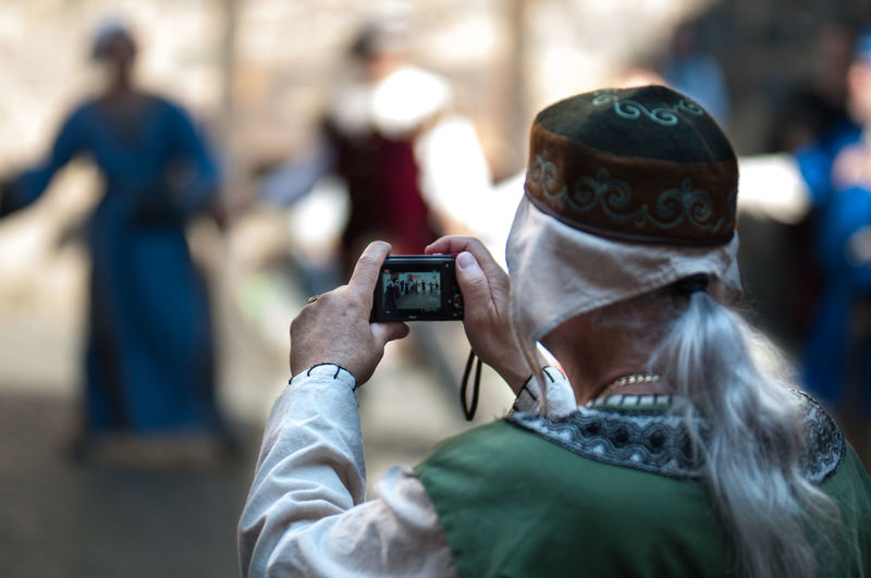 Photographer taking picture of a mobile phone