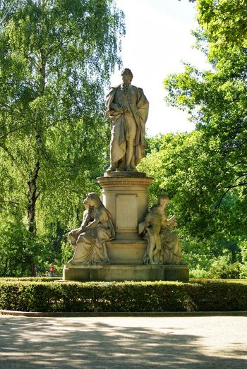 Goethe Denkmal Tiergarten Architecture Art And Craft Craft Creativity Day History Human Representation Male Likeness Memorial Nature No People Outdoors Park Park - Man Made Space Plant Representation Sculpture Statue Tree Water