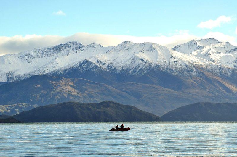 Fishing Snowy Mountains Nautical Vessel Water Mountain Lake Kayak Sky Landscape Mountain Range Cloud - Sky