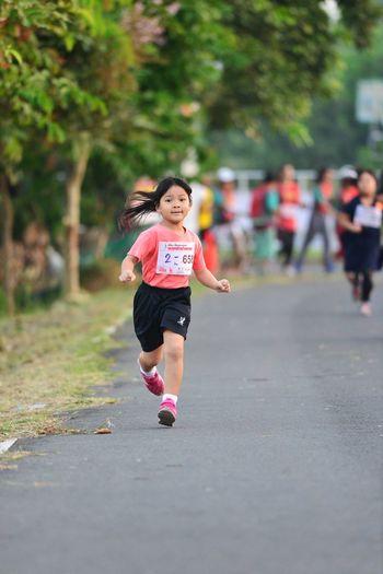 surin run Buriram thailand Kid Running Running Girl Day Focus On Foreground Front View Kid Photography Kid Race Lifestyles Marathonrunner One Person Women