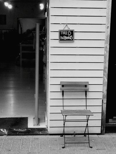 Architecture No People Text Built Structure Day Street Tired Husband Chair Clothes Shop Clothes Shop City Business Finance And Industry Blackandwhitephotography Blackandwhite Photography Black&white Blackandwhite Black And White Photography Black And White Collection  Black And White Black & White