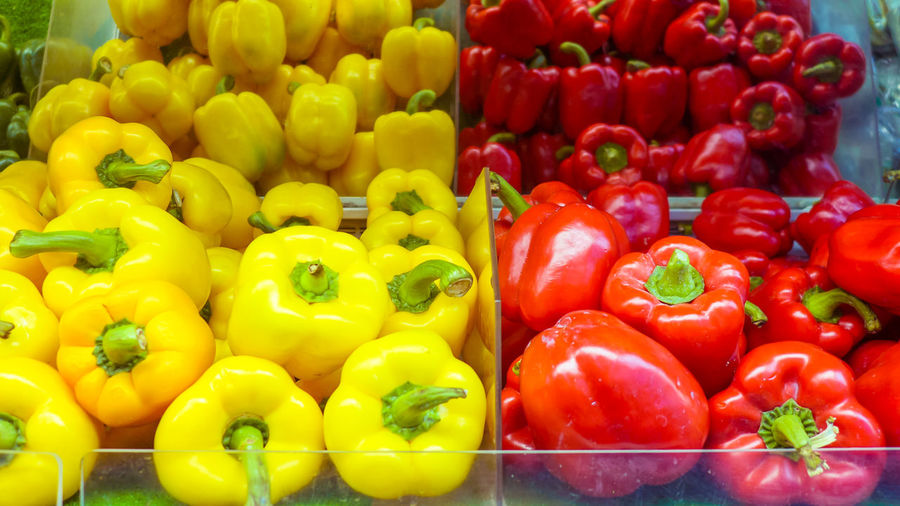 Red bell peppers for sale in market stall
