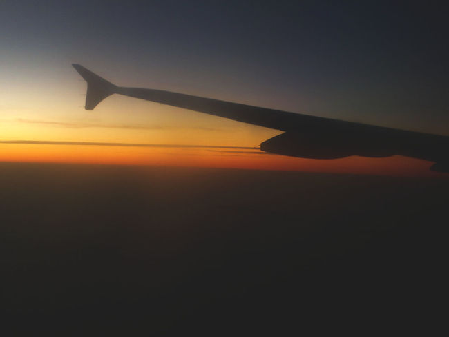 Air Vehicle Aircraft Wing Airplane Airplane Wing Beauty In Nature Day Flying Journey Nature No People Outdoors Scenics Silhouette Sky Sunset Tranquility Transportation