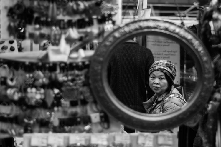 Chinese Close-up Day Hard Work Leisure Activity Lifestyles Low Angle View Market Mirror Moment Old Woman One Person Outdoors People Real People Sad Standing Young Adult Young Women The Street Photographer - 2017 EyeEm Awards