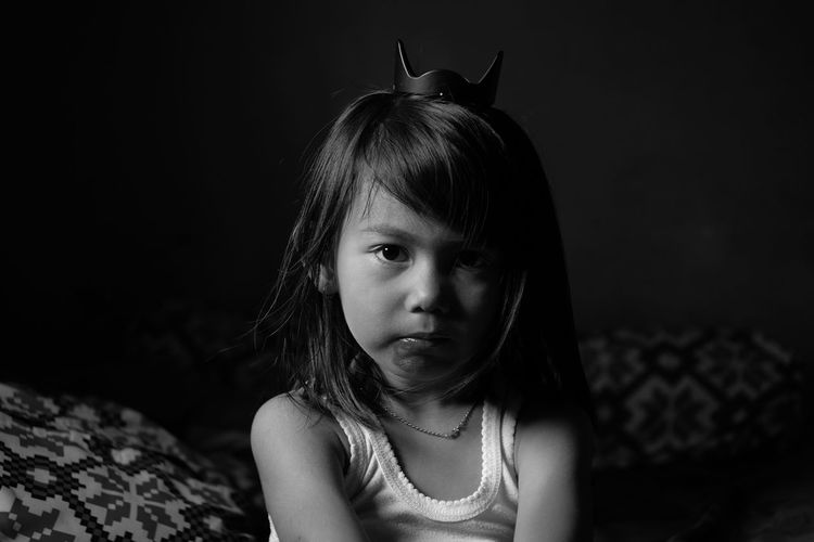 be a princes Child Black Background Childhood Girls Portrait Front View Loneliness Close-up Introspection Day Dreaming Medium-length Hair Disappointment Depression - Sadness Teardrop Hopelessness Posing Sadness Boredom Thinking Contemplation Grief Hugging Knees Thoughtful Worried Tensed