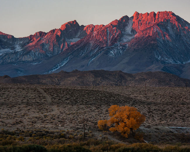 Scenic view of rocky mountain range at sunset