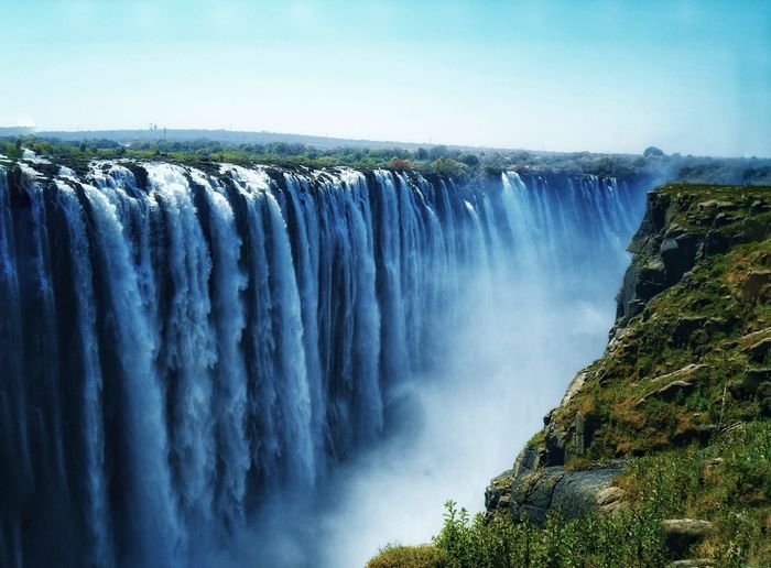 Panoramic view of the victoria waterfall against sky in zimbabwe