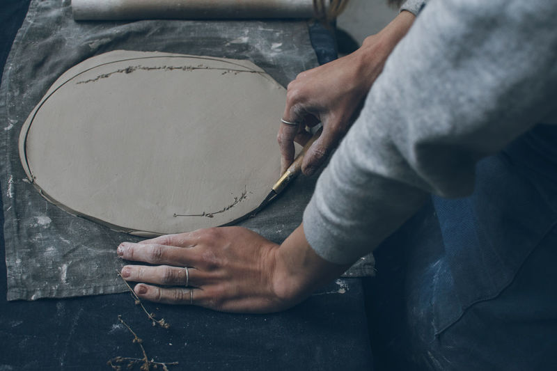 Bowl Ceramics Clay Close-up Dish Freelancer Hands At Work Hobby Human Hand Mid Section Potter Pottery Preparation  Real People Small Business Talent Tools Unrecognizable Person Woman Hands Work Table Working Workplace Workshop
