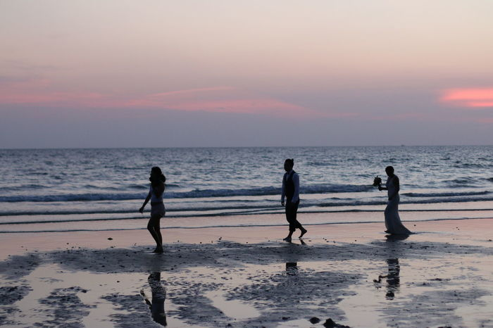 Adult Adults Only Beach Beauty In Nature Day Full Length Horizon Over Water Nature Outdoors People Sand Scenics Sea Silhouette Sky Sunset Vacations Water Wedding Wedding On The Beach Wedding Photos