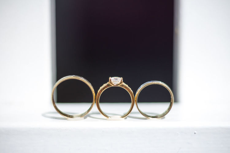 Close-up Day Diamond Ring Engagement Ring Finger Ring Gold Gold Colored Indoors  Jewelry Life Events Love No People Ring Silver  Togetherness Wedding
