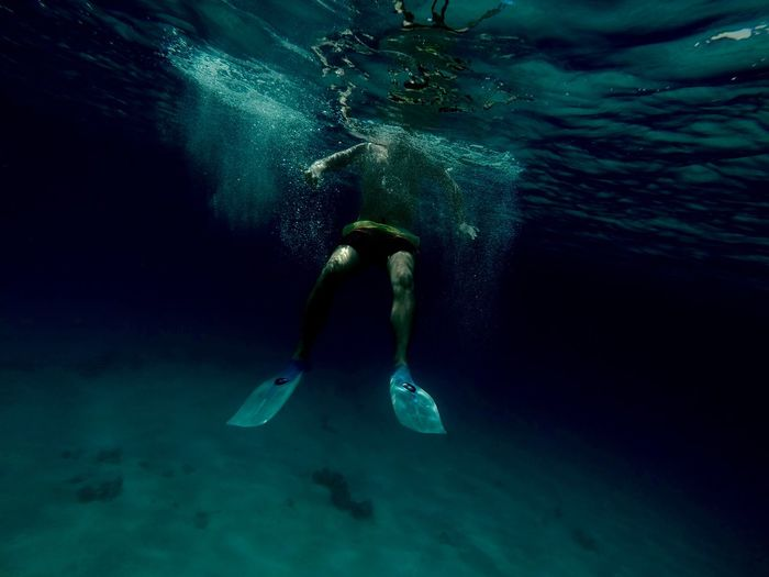 Man swimming in sea