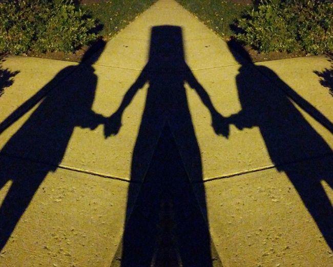 That blockhead has two girlfriends Blockhead Shadows Self Selfie ✌ Holding Hands Men Sunlight Yellow Focus On Shadow Long Shadow - Shadow Friend Couple Female Likeness