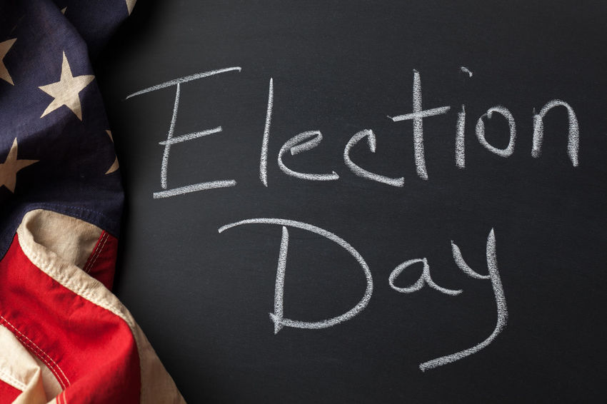 Election Day written on a chalkboard draped by a vintage American flag Flag American Flag Americana Democracy Black Color Blackboard  Board Chalk Drawing Close-up Communication Election Day Handwriting  High Angle View Message No People Republic Text Vintage Voting Western Script Writing