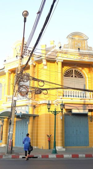 wire life in the old city Bangkok Yellow Mustard Street Crossing Lady Electric Wire Old City Architecture Building Exterior Built Structure Real People One Person Full Length Outdoors Day City Women People