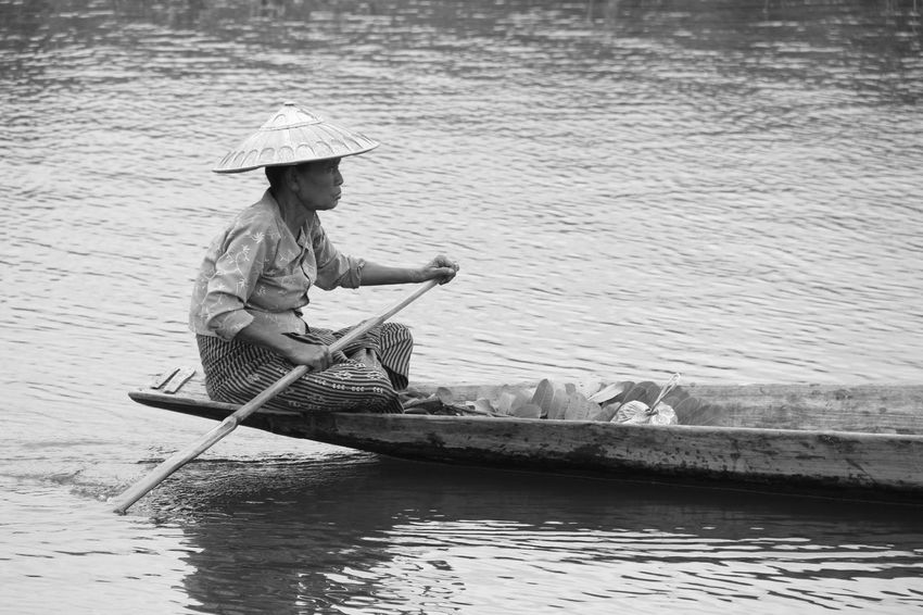 This amazing peaceful expression on her face Black And White Boat Face Expression Inle Lake Myanmar Nature Pedal Boat People Real People Water Woman