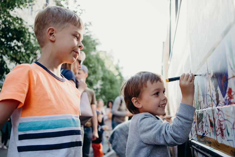 Boys Casual Clothing Child Childhood Day Focus On Foreground Incidental People Innocence Lifestyles Looking Males  Men Offspring Outdoors People Portrait Real People Smiling Standing Waist Up