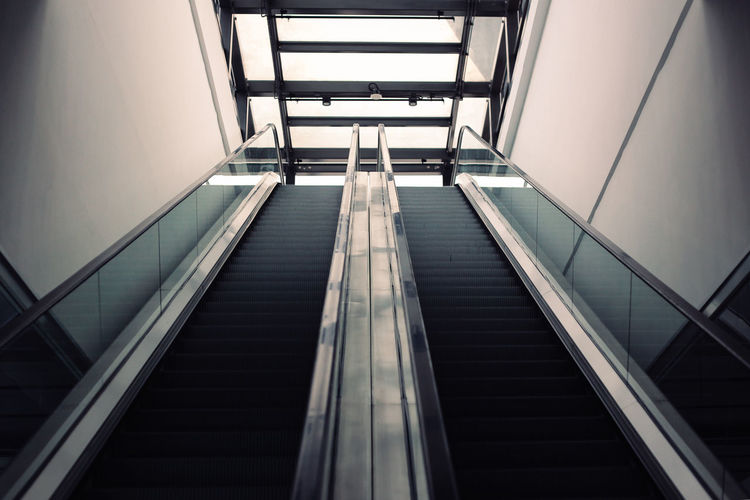 Architecture Building Building Exterior Built Structure Diminishing Perspective Escalator Indoors  Learn & Shoot: Balancing Elements Low Angle View Modern No People Pattern Railing Staircase Steps Steps And Staircases Two Is Better Than One 17.62°