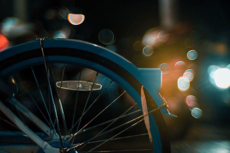 Close-up of illuminated bicycle at night