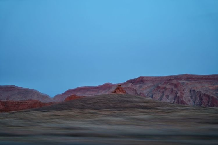View of mexican hat rock formation against clear blue sky