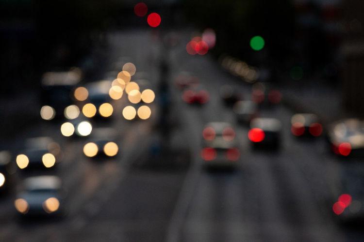 Defocused image of illuminated city street