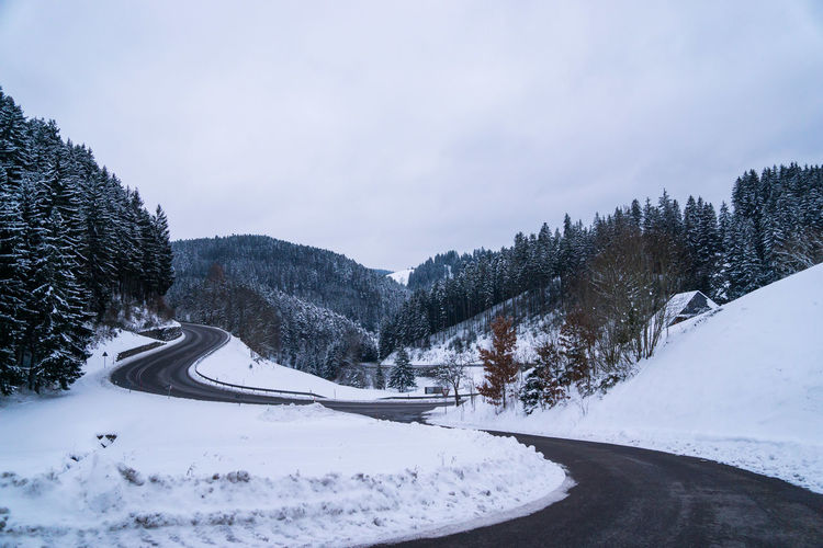 Snow Winter Cold Temperature Sky Beauty In Nature Tree Plant Scenics - Nature Cloud - Sky Tranquility Nature No People Tranquil Scene White Color Mountain Road Day Transportation Covering Outdoors Snowcapped Mountain Black Forest