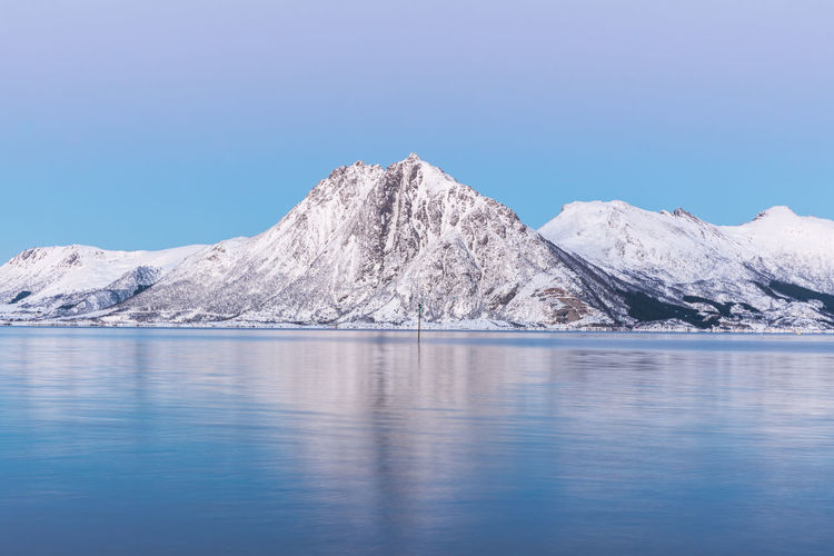 Beauty In Nature Blue Cold Temperature Day Dust Frozen Landscape Long Exposure Mountain Mountain Range Nature No People Norway Outdoors Reflection Scenics Sky Snow Tranquil Scene Tranquility Vesterålen Water Waterfront Winter The Great Outdoors - 2017 EyeEm Awards Perspectives On Nature